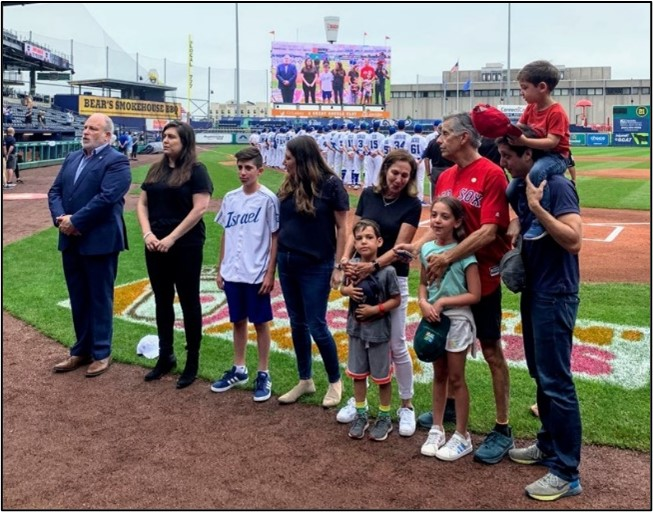 Ambassador Meron Reuben, Dar Nadler, Sara Hefez, the Aronson Family and Team Israel fans sing Israel's national anthem before Team Israel vs. Bristol Blues