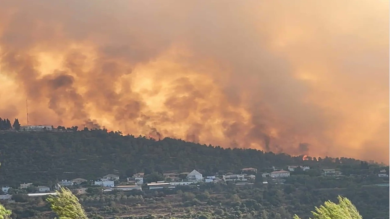Residents evacuated as wildfire threatened homes near Israel's largest city - credit YNet News